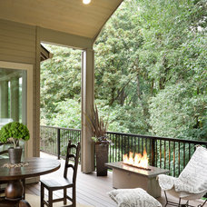 rustic porch by Alan Mascord Design Associates Inc