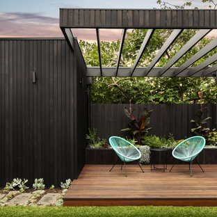 This is an example of a contemporary backyard deck in Melbourne with a pergola.