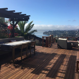 Trendy rooftop deck photo in San Francisco with a fire pit and a pergola