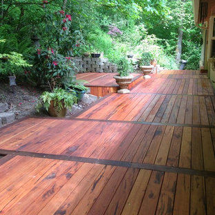 Inspiration for a large craftsman backyard deck remodel in Portland
