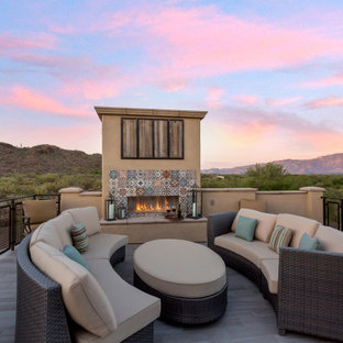 Inspiration for a southwestern deck remodel in Other with a fireplace and no cover