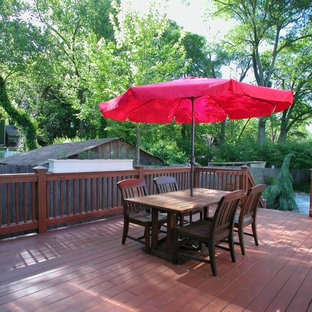 Example of a large ornate backyard deck design in Atlanta with no cover
