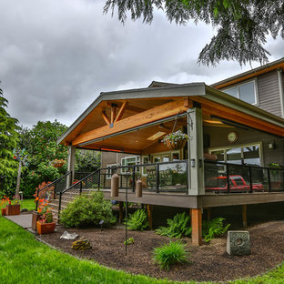Inspiration for a large modern backyard outdoor kitchen deck remodel in Seattle with a roof extension