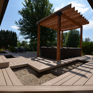 Mid-sized elegant backyard deck photo in Chicago with a pergola