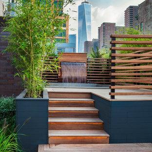 Idee per una terrazza design sul tetto e sul tetto con fontane e nessuna copertura