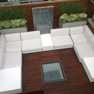 Inspiration for a large contemporary rooftop water fountain deck remodel in New York with no cover