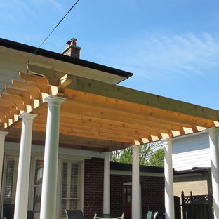 Photo of a medium sized mediterranean back terrace and balcony in Toronto with a pergola.