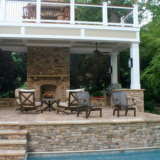 Deck - large traditional backyard deck idea in Atlanta with a fireplace and a roof extension