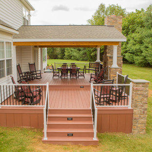 Deck - mid-sized rustic backyard deck idea in Other with a fire pit and a roof extension
