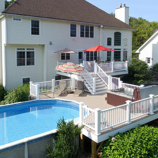 Example of a large classic backyard deck design in New York