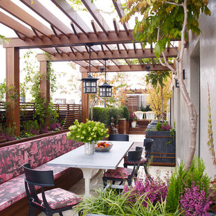 Trendy rooftop rooftop deck container garden photo in New York with a pergola