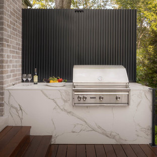 Photo of a small modern back terrace and balcony in Toronto with an outdoor kitchen and no cover.
