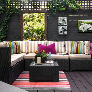 Trendy deck photo in Vancouver with a roof extension