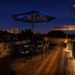 Idee per una terrazza industriale di medie dimensioni e sul tetto con un parasole