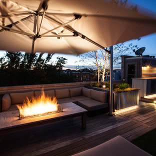 Design ideas for a medium sized urban roof terrace and balcony in Chicago with a fire feature and no cover.