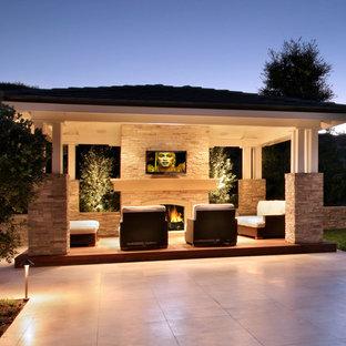 Ispirazione per una terrazza mediterranea di medie dimensioni e dietro casa con un giardino in vaso