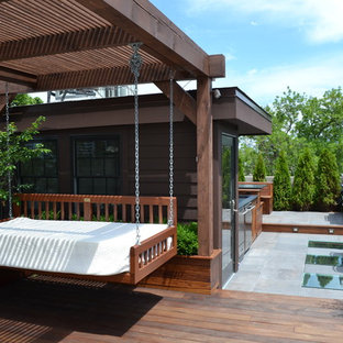 This is an example of a large contemporary roof terrace and balcony in Chicago with an outdoor kitchen and a pergola.