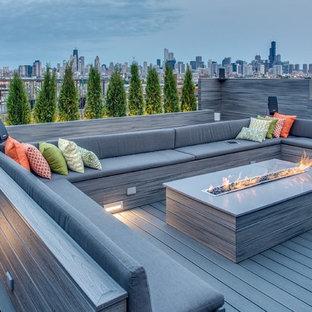 Immagine di una grande terrazza minimal sul tetto e sul tetto con un focolare e nessuna copertura