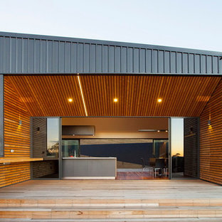 Photo of a contemporary side yard deck in Hobart with no cover.