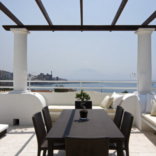 Inspiration for an expansive mediterranean rooftop deck in Rome with a pergola.