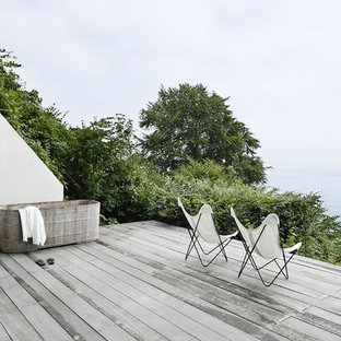 Example of a large danish outdoor shower deck design in Copenhagen with no cover