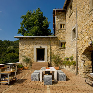 Inspiration for an expansive mediterranean back terrace and balcony in Florence with an outdoor kitchen.