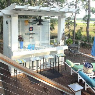 Outdoor kitchen deck - mid-sized beach style backyard outdoor kitchen deck idea in Charleston