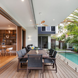 Design ideas for a contemporary deck in Brisbane with a roof extension.