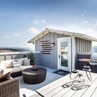 Foto di una terrazza chic sul tetto e sul tetto con nessuna copertura