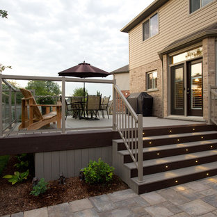 Example of a large trendy backyard deck skirting design in Toronto with no cover