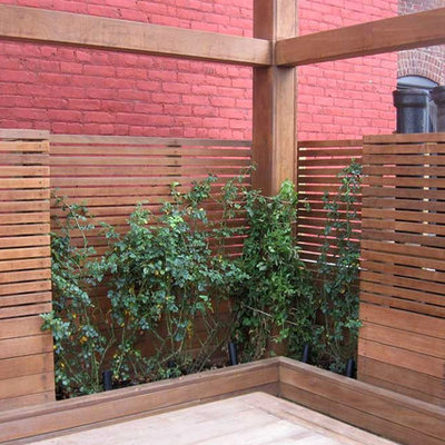 Large trendy rooftop deck container garden photo in New York with no cover