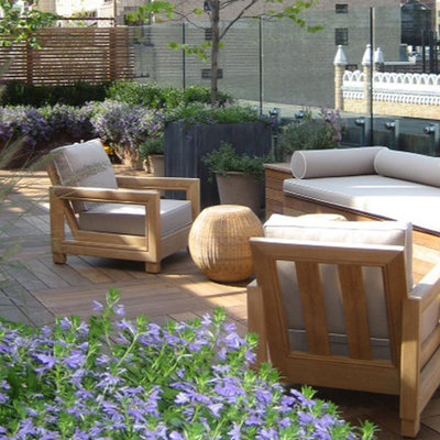 Example of a large trendy rooftop deck container garden design in New York with no cover