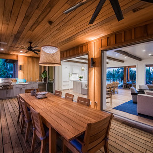 Island Style Outdoor Kitchen Deck Photo In Tampa With A Roof Extension