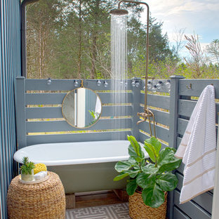 Design ideas for a beach style deck in Nashville with an outdoor shower and no cover.