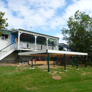 Photo of a medium sized victorian back terrace and balcony in Brisbane with an outdoor kitchen and a roof extension.