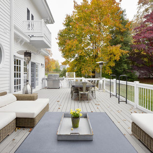 Large ornate backyard deck photo in New York with no cover