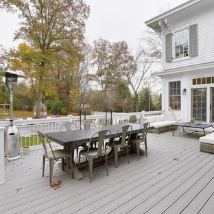 Example of a large ornate backyard deck design in New York with no cover