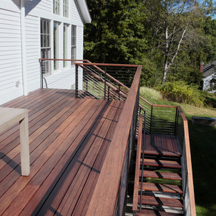 Inspiration for a mid-sized modern backyard deck remodel in Boston with no cover