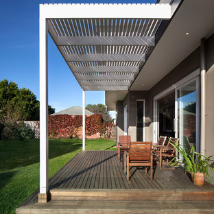 Medium sized contemporary back terrace in Melbourne with a pergola.