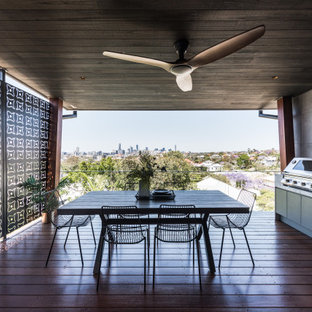Photo of a contemporary deck in Brisbane with an outdoor kitchen.