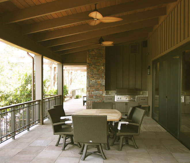 Rustic Porch by Mahoney Architects & Interiors