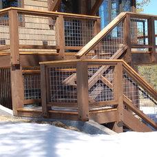 Rustic Deck by Stone Aspen Signature Builders