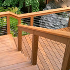 wood framed cable railing systems - Painted cedar and composite cap with stainless steel cable. Complete kits available.