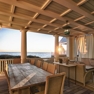 Beach style deck photo in Other with a roof extension