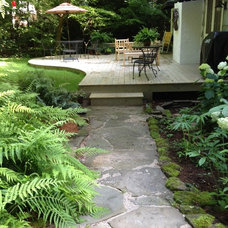 Traditional Deck by Earth Design, Inc.