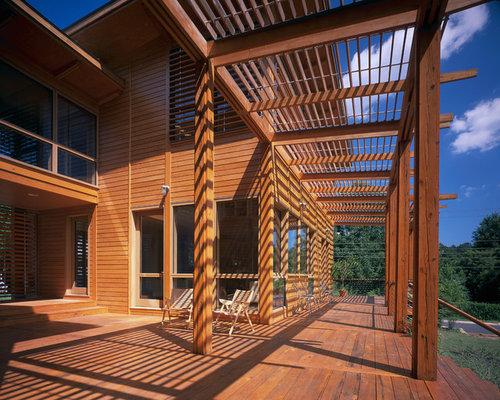 Small Modern Backyard Deck In Richmond With A Pergola