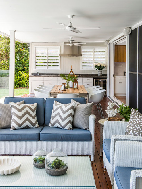 inspiration for a timeless backyard outdoor kitchen deck remodel in brisbane with a roof extension - Deck Ideen Design