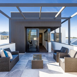 Photo of a contemporary rooftop deck in Perth with a pergola.
