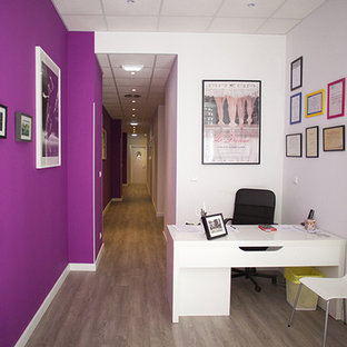 Medium sized contemporary home studio in Other with purple walls, medium hardwood flooring, no fireplace and a built-in desk.