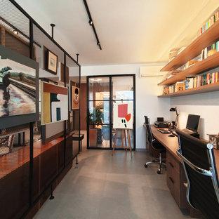 Imagen de despacho actual con paredes blancas, escritorio empotrado y suelo gris